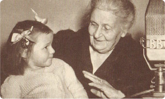 Image of Maria Montessori interacting with a child